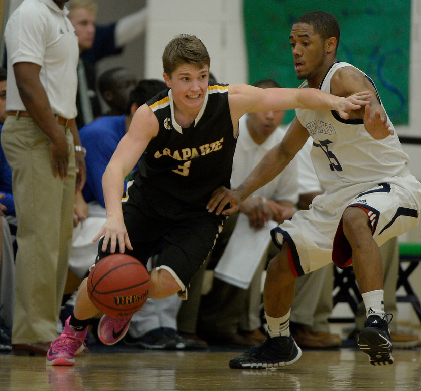 . AURORA, CO - FEBRUARY 12: Arapahoe Nick Farmen (3) drives around Overland Austin Conway (15)  during their 5A basketball game February 12, 2014 in Aurora. (Photo by John Leyba/The Denver Post)
