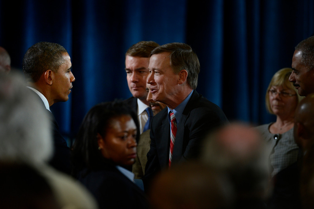 . DENVER, CO. - APRIL 03: President Barack Obama greets Colorado Governor John Hickenlooper after speaking to uniformed officers and community leaders at the Denver Police Academy calling for Congress to act more like the state\'s Democratic-controlled legislature to pass stronger gun-control laws. (Photo By Joe Amon/The Denver Post)