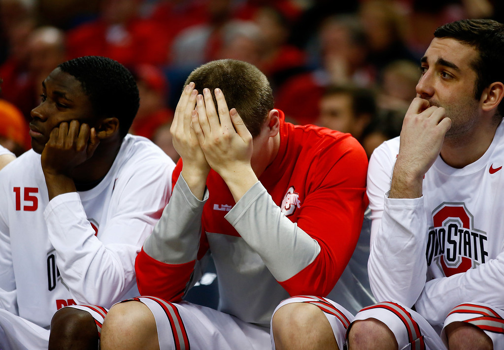 . The Ohio State Buckeyes bench looks on during the second round of the 2014 NCAA Men\'s Basketball Tournament against the Dayton Flyers at the First Niagara Center on March 20, 2014 in Buffalo, New York. The Dayton Flyers defeated the Ohio State Buckeyes 60-59. (Photo by Jared Wickerham/Getty Images)