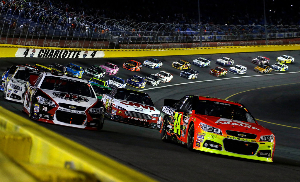 . Jeff Gordon (24) leads the field of drivers out of Turn 4 approaching the start of the NASCAR Sprint Cup Series auto race at Charlotte Motor Speedway in Concord, N.C., Saturday, Oct. 12, 2013. (AP Photo/Gerry Broome)