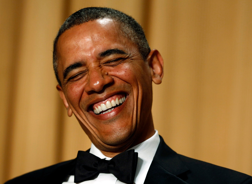 . U.S. President Barack Obama laughs as comedian Conan O\'Brien speaks during the White House Correspondents Association Dinner in Washington April 27, 2013  REUTERS/Kevin Lamarque