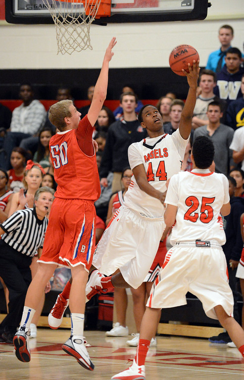 . East\'s Leonard Davis (44), center, makes takes a shot past Creek\'s Graham Pingree (50), left, in the 2nd half of the game at East High School on Friday, Nov. 30, 2012. Hyoung Chang, The Denver Post