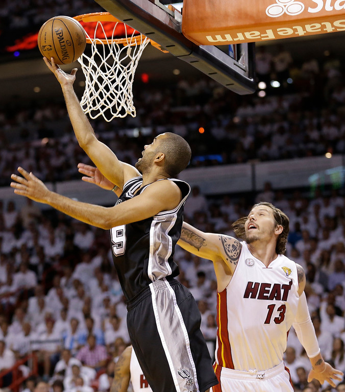 . San Antonio Spurs\' Tony Parker (9) shoots against the Miami Heat\'s Mike Miller (13) during the first half in Game 7 of the NBA basketball championships, Thursday, June 20, 2013, in Miami. (AP Photo/Lynne Sladky)