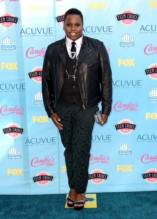 . Alex Newell arrives at the Teen Choice Awards at the Gibson Amphitheater on Sunday, Aug. 11, 2013, in Los Angeles.(Photo by Jordan Strauss/Invision/AP)