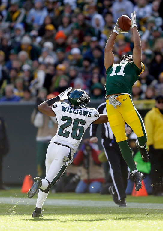 . Green Bay Packers\' Jarrett Boykin goes up for a pass over Philadelphia Eagles\' Cary Williams (26) during the first half of an NFL football game Sunday, Nov. 10, 2013, in Green Bay, Wis. (AP Photo/Mike Roemer)