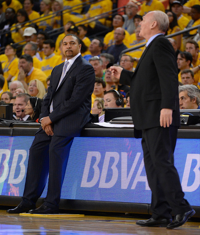 . Mark Jackson of the Golden State Warriors looks over at George Karl of the Denver Nuggets as he calls in the play during the second quarter in Game 6 of the first round NBA Playoffs May 2, 2013 at Oracle Arena. (Photo By John Leyba/The Denver Post)