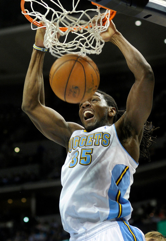 . Denver forward Kenneth Faried (35) stuffed two points through the hoop in the second half. The Minnesota Timberwolves took a bite out of the Denver Nuggets winning 101-97 at the Pepsi Center Thursday night, January 3, 2013. Karl Gehring/The Denver Post