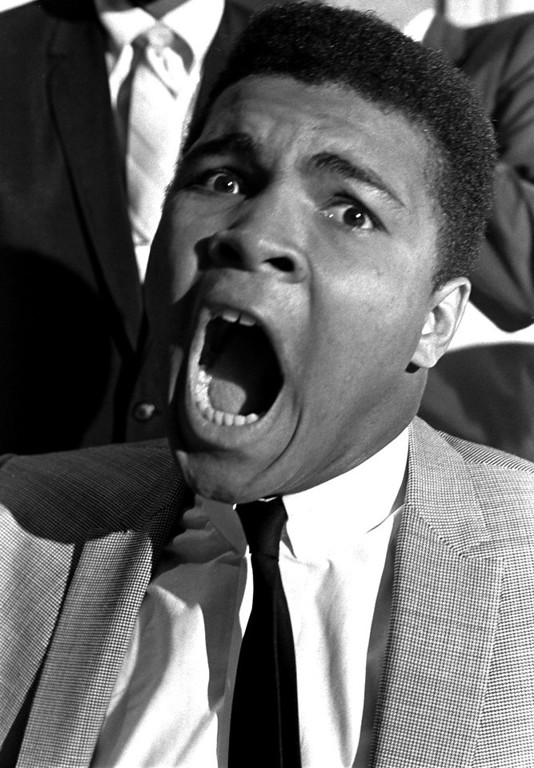 """. Challenger Cassius Clay is shown in rare form as he signed to meet heavyweight boxing champion Sonny Liston, in this Nov. 6, 1963 file photo. A new book, \""""Ali Rap: Muhammad Ali the First Heavyweight Champion of Rap,\"""" proclaims Ali\'s verbal barrage was more than self-promotion, but sowed the seeds of hip-hop, which came into being in the `70s.   (AP Photo/stf/FILE)"""