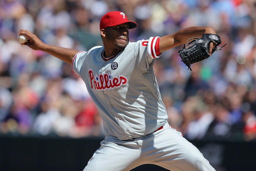 . Starting pitcher Roberto Hernandez #27 of the Philadelphia Phillies delivers against the Colorado Rockies at Coors Field on April 20, 2014 in Denver, Colorado.  (Photo by Doug Pensinger/Getty Images)