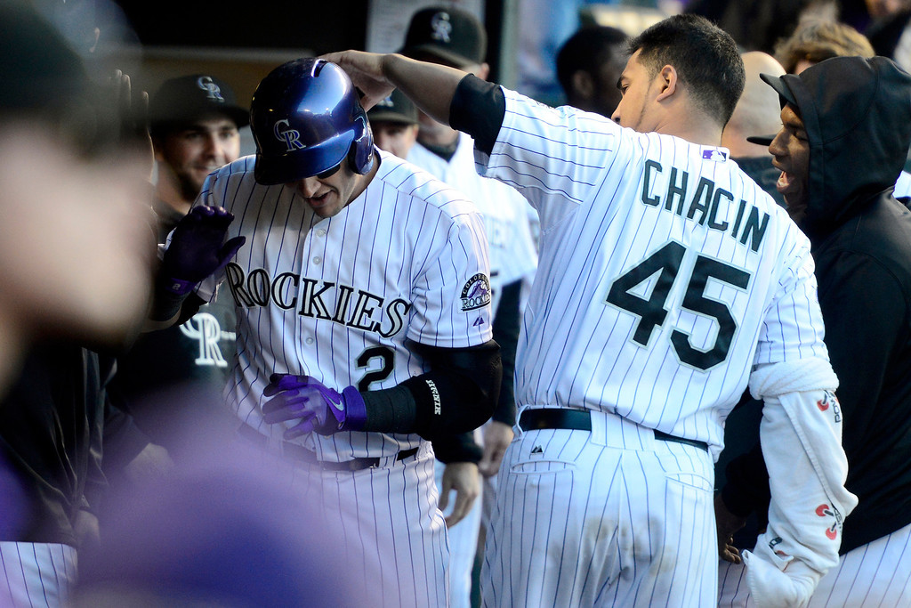 . DENVER, CO - MAY 21: Jhoulys Chacin (45) of the Colorado Rockies pats Troy Tulowitzki (2) on the head after he hit a solo home run off of Ian Kennedy (31) of the Arizona Diamondbacksduring action at Coors Field. The Arizona Diamondbacks visited the Colorado Rockies. (Photo by AAron Ontiveroz/The Denver Post)
