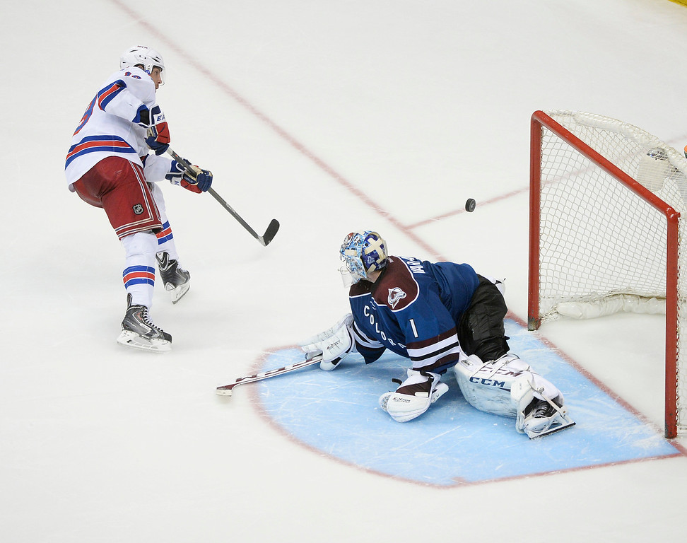 . Colorado goalie Semyon Varlamov (1) rejected a shot by New York center Brad Richards (19) to seal the win in a shootout Thursday night.   (Photo by Karl Gehring/The Denver Post)