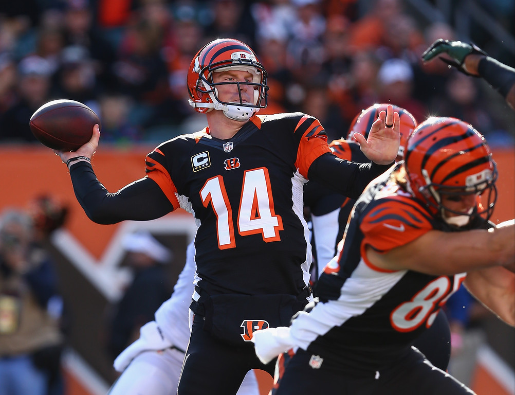 . Andy Dalton #14 of the Cincinnati Bengals throws a pass during the NFL game against the New York Jets at Paul Brown Stadium on October 27, 2013 in Cincinnati, Ohio.  (Photo by Andy Lyons/Getty Images)