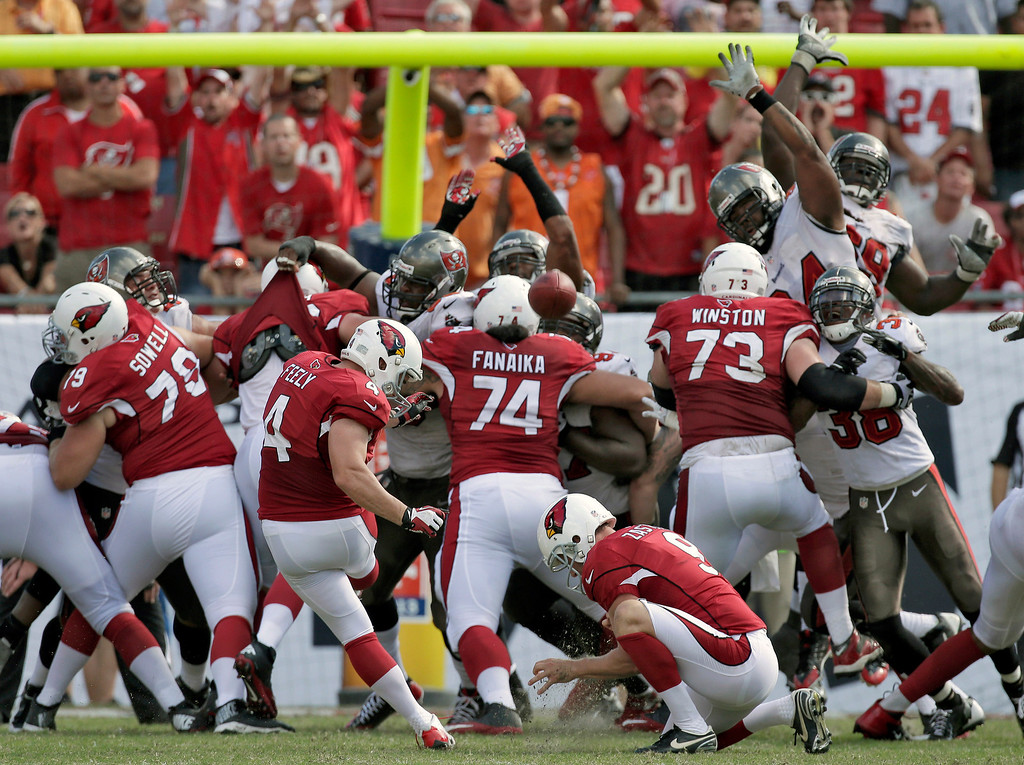 . Arizona Cardinals kicker Jay Feely (4) kicks what proved to be a game-winning 27-yard field goal against the Tampa Bay Buccaneers during the fourth quarter of an NFL football game on Sunday, Sept. 29, 2013, in Tampa, Fla. The Cardinals won the game 13-10. (AP Photo/Chris O\'Meara)