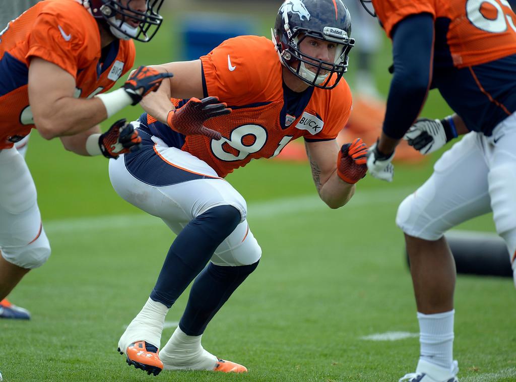 . Denver Broncos tight end Joel Dreessen (81) runs through drills during practice September 19, 2013 at Dove Valley. (Photo by John Leyba/The Denver Post)