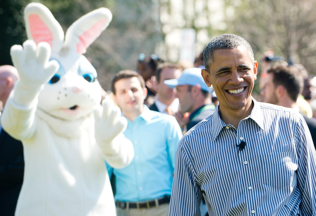 . US President Barack Obama attends the White House Easter Egg Roll alongside the Easter Bunny on the South Lawn of the White House in Washington, DC, April 1, 2013. Obama hosts the annual event, featuring live music, sports courts, cooking stations, storytelling and Easter egg rolling. AFP PHOTO / Saul LOEB/AFP/Getty Images