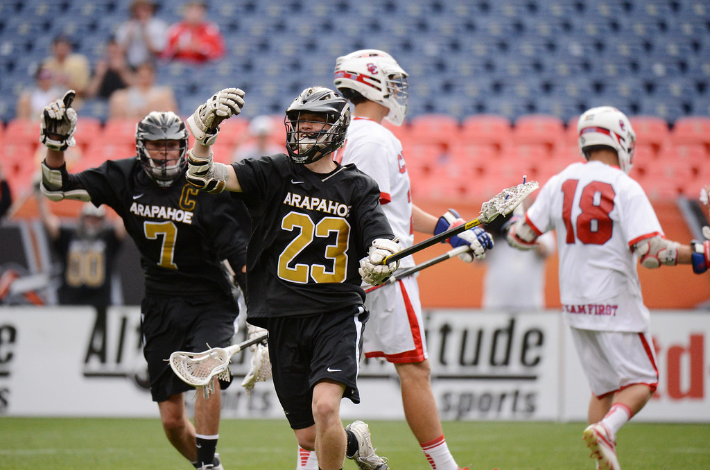 . DENVER, CO. - MAY 18 : Riley Banks of Arapahoe High School (23) celebrates his goal in the 2nd half of 5A Boy\'s Lacrosse Championship game against Cherry Creek High School at Sports Authority Field at Mile High Stadium. Denver, Colorado. May 18, 2013. Arapahoe won 10-7. (Photo By Hyoung Chang/The Denver Post)