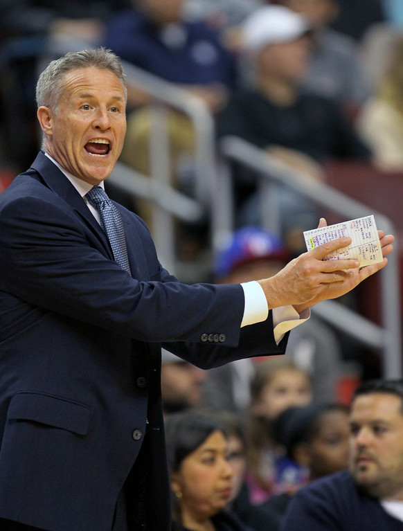 . Philadelphia 76ers Brett Brown calls a play against the Denver Nuggets in the first half of an NBA basketball game Saturday Dec. 7, 2013, in Philadelphia. The Nuggets won 103-92.  (AP Photo/H. Rumph Jr)