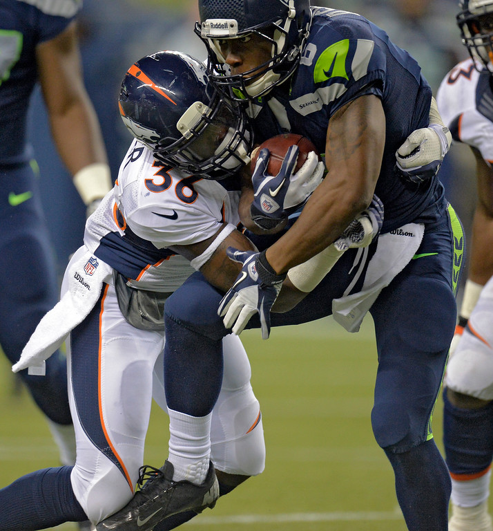 . SEATTLE, WA. - AUGUST 17: Denver Broncos cornerback Kayvon Webster (36) puts a hit on Seattle Seahawks wide receiver Perez Ashford (6) after a catch in the fourth quarter August 17, 2013 at Century Link Field. (Photo By John Leyba/The Denver Post)