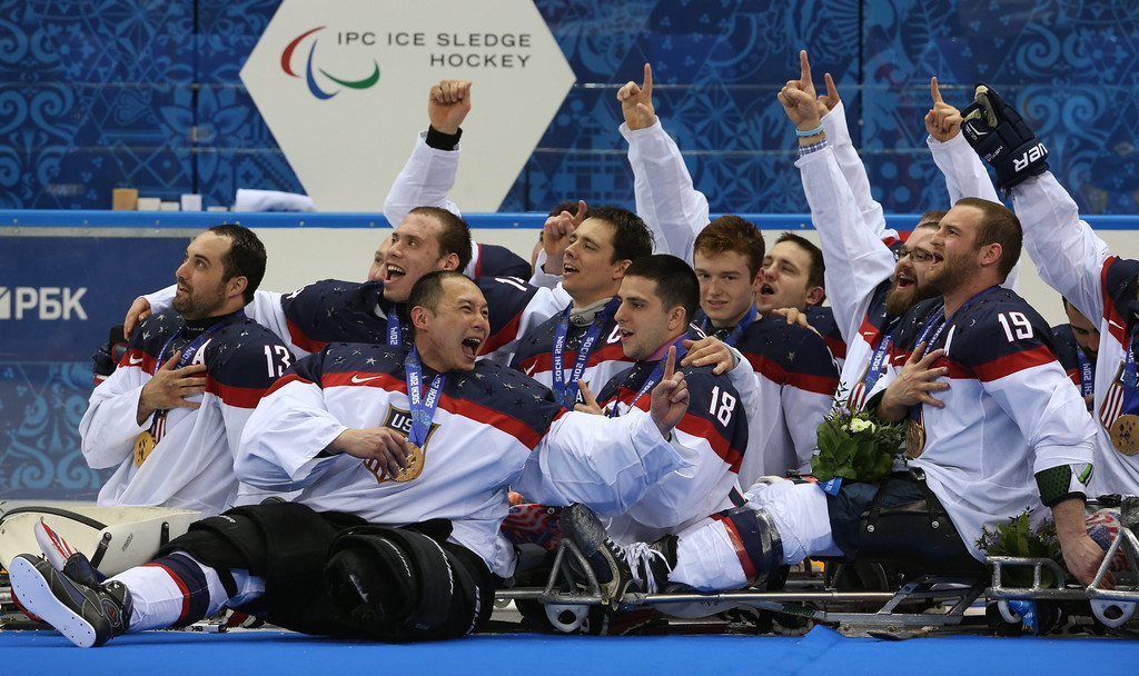 . Team of the USA listens to the national anthem during the awarding ceremony after the Ice Sledge Hockey final match Russia vs USA at Sochi 2014 Paralympic Games, Russia, 15 March 2014. USA took the first place.  EPA/SERGEI CHIRIKOV