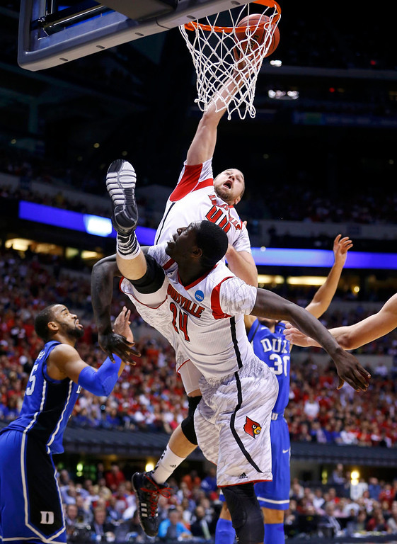 . Louisville Cardinals forward Stephan Van Treese (44) collides with teammate Montrezl Harrell (24) as he tries to score against the Duke Blue Devils in the first half during their Midwest Regional NCAA men\'s basketball game in Indianapolis, Indiana, March 31, 2013. REUTERS/Jeff Haynes