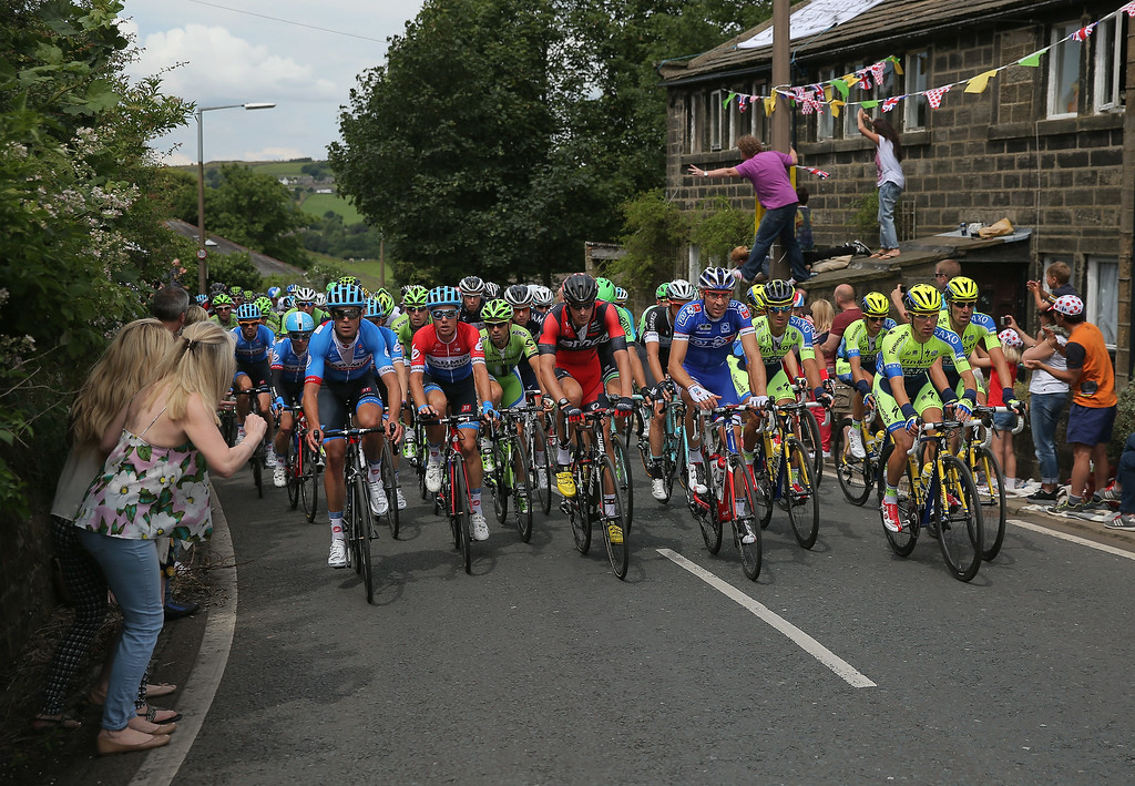 . OXENHOPE, ENGLAND - JULY 06:  The peloton makes the claim of the Cote d\'Oxenhope Moor during stage two of the 2014 Le Tour de France from York to Sheffield on July 6, 2014 in Oxenhope, United Kingdom.  (Photo by Doug Pensinger/Getty Images)