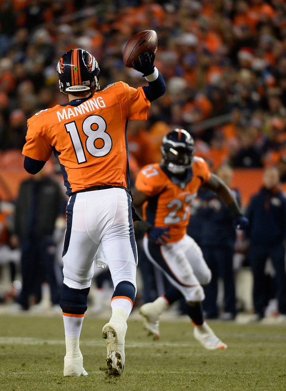 . Denver Broncos quarterback Peyton Manning (18) looks to pass during the first quarter. The Denver Broncos vs. the San Diego Chargers at Sports Authority Field at Mile High in Denver on December 12, 2013. (Photo by John Leyba/The Denver Post)