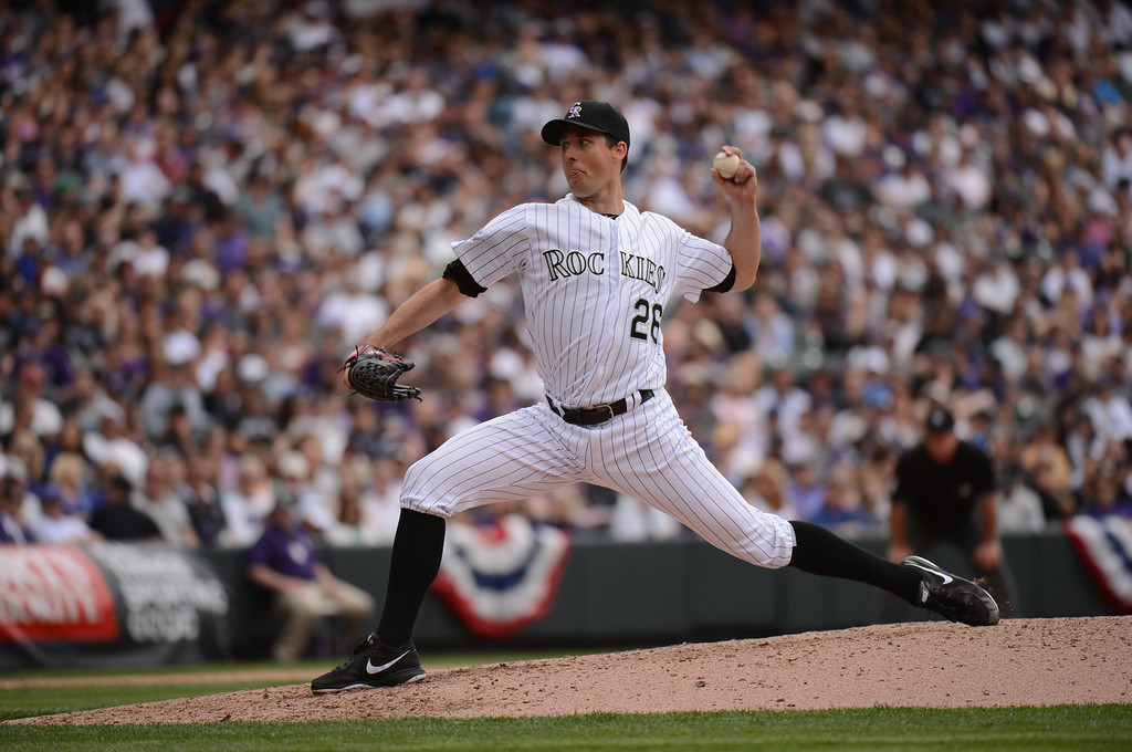 . Jeff Francis (26) of the Colorado Rockies delivers a pitch in the sixth inning. (Photo by Hyoung Chang/The Denver Post)