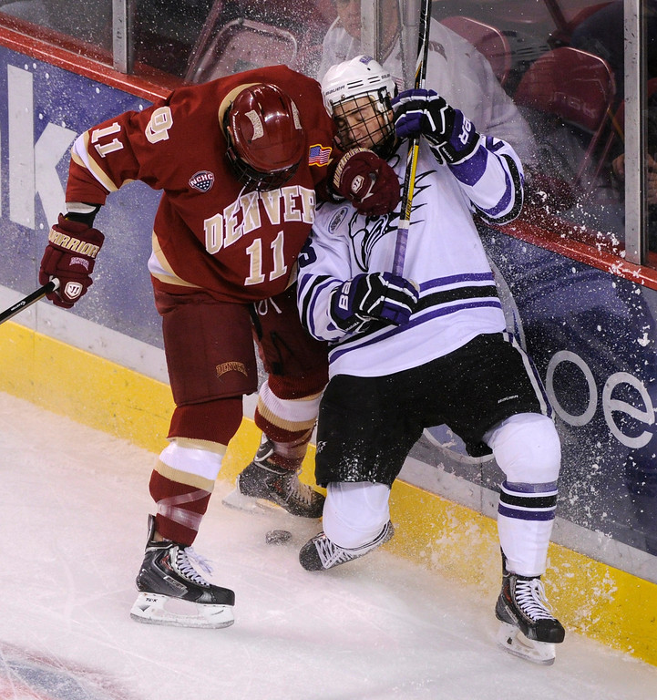 . DENVER, CO. - OCTOBER 25: Denver defenseman Nolan Zajac (11) battled for the puck with Niagara wing Matt Chartrain (23) in the first period. The University of Denver hockey team hosted Niagara at Magness Arena Friday night, October 25, 2013. Photo By Karl Gehring/The Denver Post