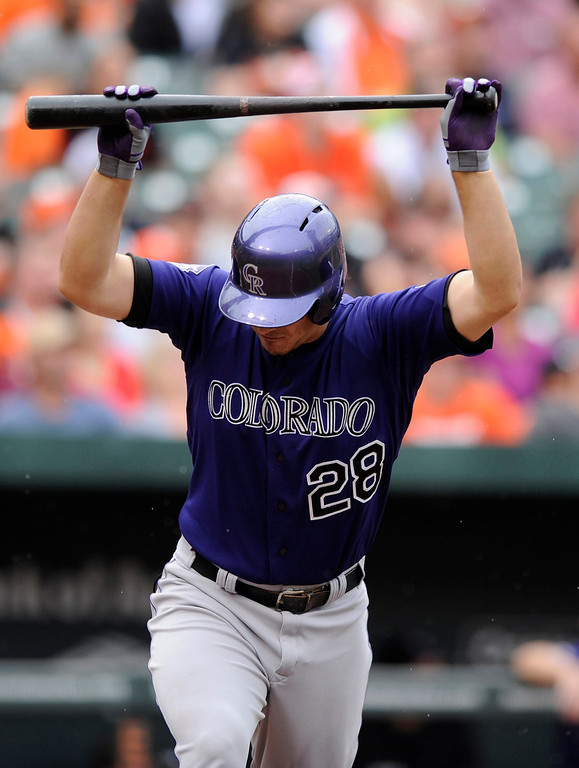 . Colorado Rockies\' Nolan Arenado reacts after he popped out against the Baltimore Orioles during the fourth inning of a baseball game on Sunday, Aug. 18, 2013, in Baltimore. (AP Photo/Nick Wass)