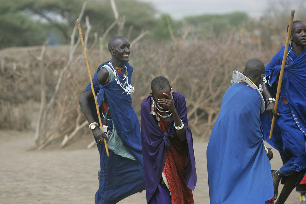 . Masai dancers have a happy moment in a village near Ngorongoro Crater Conservation area in Tanzania, Africa.