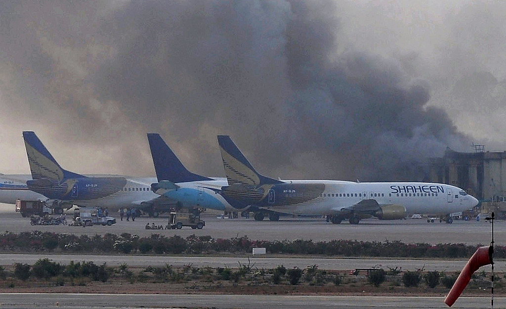 . Smoke rises after militants launched an early morning assault at Jinnah International Airport in Karachi on June 9, 2014.  Pakistan\'s security forces said on June 9 they have relaunched a military operation at Karachi airport as gunfire resumed several hours after they announced the end of a militant siege that left 24 dead.      AFP PHOTO / Rizwan TABASSUM/AFP/Getty Images