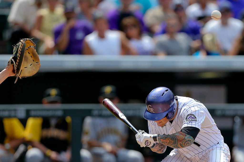 . Brandon Barnes #1 of the Colorado Rockies ducks out of the way of a high pitch during the second inning against the Pittsburgh Pirates at Coors Field on July 27, 2014 in Denver, Colorado. The Pirates defeated the Rockies 7-5. (Photo by Justin Edmonds/Getty Images)
