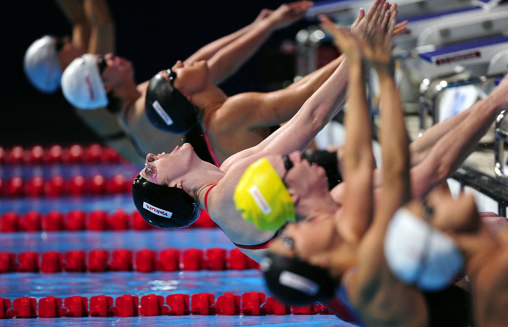 . US swimmer Missy Franklin (C) competes in the final of the women\'s 100-metre backstroke swimming event in the FINA World Championships at Palau Sant Jordi in Barcelona on July 30, 2013.  JOSEP LAGO/AFP/Getty Images