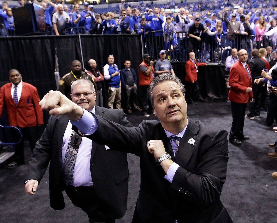 . Kentucky head coach John Calipari celebrates after an NCAA Midwest Regional final college basketball tournament game against Michigan Sunday, March 30, 2014, in Indianapolis. Kentucky won 75-72 to advance to the Final Four. (AP Photo/David J. Phillip)