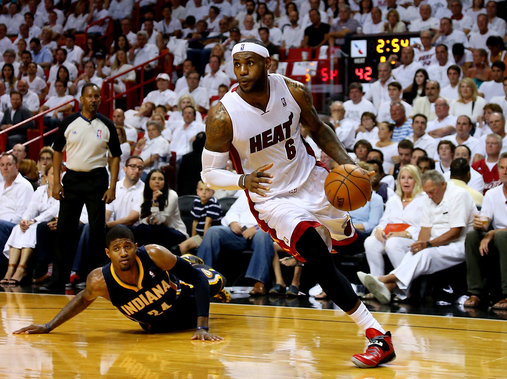 . LeBron James #6 of the Miami Heat drives to the basket as Paul George #24 of the Indiana Pacers defends during Game Four of the Eastern Conference Finals of the 2014 NBA Playoffs at American Airlines Arena on May 26, 2014 in Miami, Florida.  (Photo by Mike Ehrmann/Getty Images)