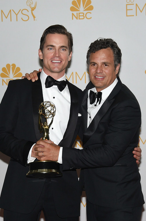 """. Actor Matt Bomer (L) and Mark Ruffalo, winners of the Outstanding Television Movie for \""""The Normal Heart\"""" pose in the press room during the 66th Annual Primetime Emmy Awards held at Nokia Theatre L.A. Live on August 25, 2014 in Los Angeles, California.  (Photo by Jason Merritt/Getty Images)"""