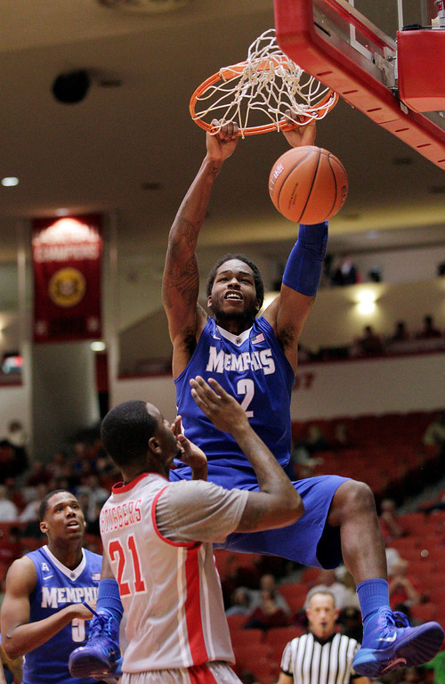 . Memphis\' forward Shaq Goodwin (2) dunks over Houston\'s  Jherrod Stiggers (21) during the first half of an NCAA college basketball game, Thursday, Feb. 27, 2014, in Houston. (AP Photo/Bob Levey)