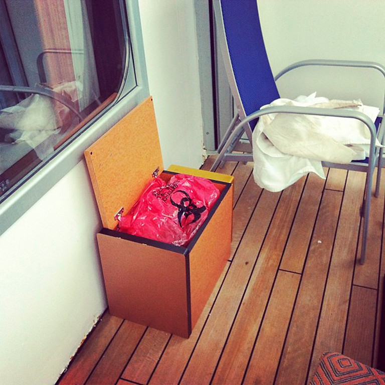. A bag of human waste lies in a box on the outdoor deck of a room on the Carnival Cruise ship Triumph in this February 14, 2013 handout photo courtesy of Jacob Combs. Passengers were left without working toilets after the Triumph lost power February 10 after a fire in the engine room, which left 4,220 people enduring food shortages and unsanitary conditions.  REUTERS/Jacob Combs/Handout