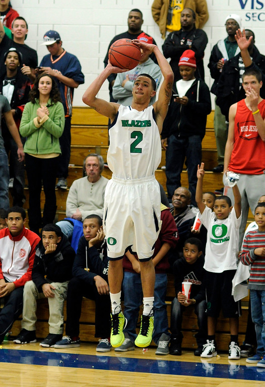 . Blazers guard Taren Williams (2) had an open shot from the corner in the second half. The Overland High School boy\'s basketball team defeated Regis Jesuit 80-66 Tuesday night, December 11, 2012.  Karl Gehring/The Denver Post