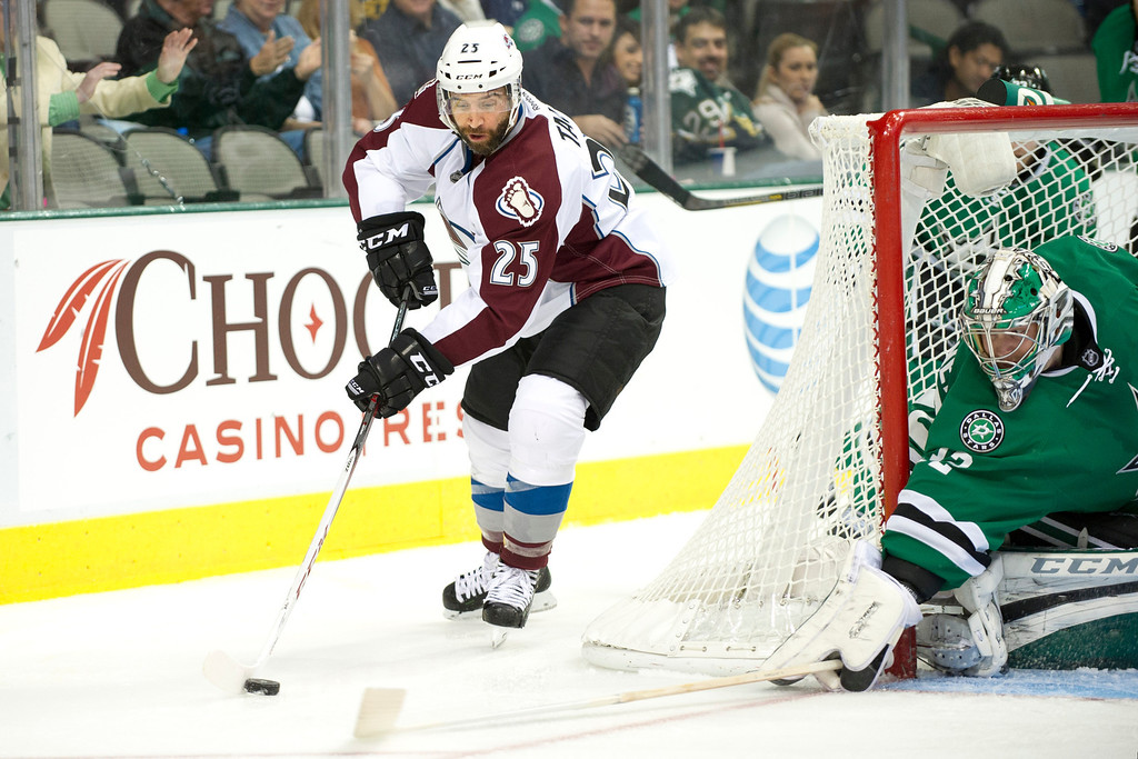 . DALLAS, TX - NOVEMBER 1:  Maxime Talbot #25 of the Colorado Avalanche goes for a wrap around shot against Kari Lehtonen #32 of the Dallas Stars on November 1, 2013 at the American Airlines Center in Dallas, Texas.  (Photo by Cooper Neill/Getty Images)