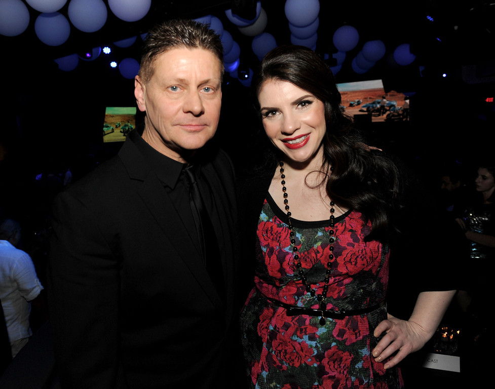 """. Writer/director Andrew Niccol (L) and writer/producer Stephenie Meyer pose at the after party for the premiere of Open Road Films\' \""""The Host\"""" at Lure on March 19, 2013 in Los Angeles, California.  (Photo by Kevin Winter/Getty Images)"""