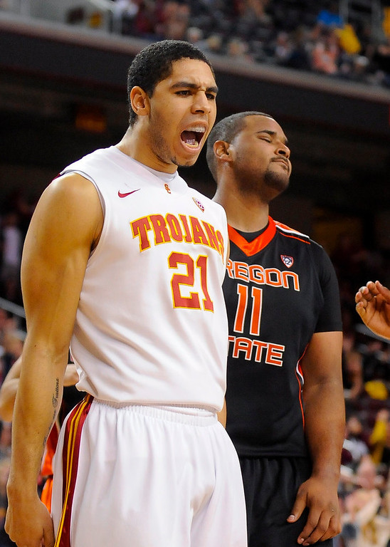 . Southern Cal forward Aaron Fuller (21) and Oregon State forward Joe Burton (11) react to basket giving Southern Cal the lead late during the second half of an NCAA college basketball game, Saturday, Jan. 19, 2013, in Los Angeles. Southern Cal won 69-68. (AP Photo/Gus Ruelas)
