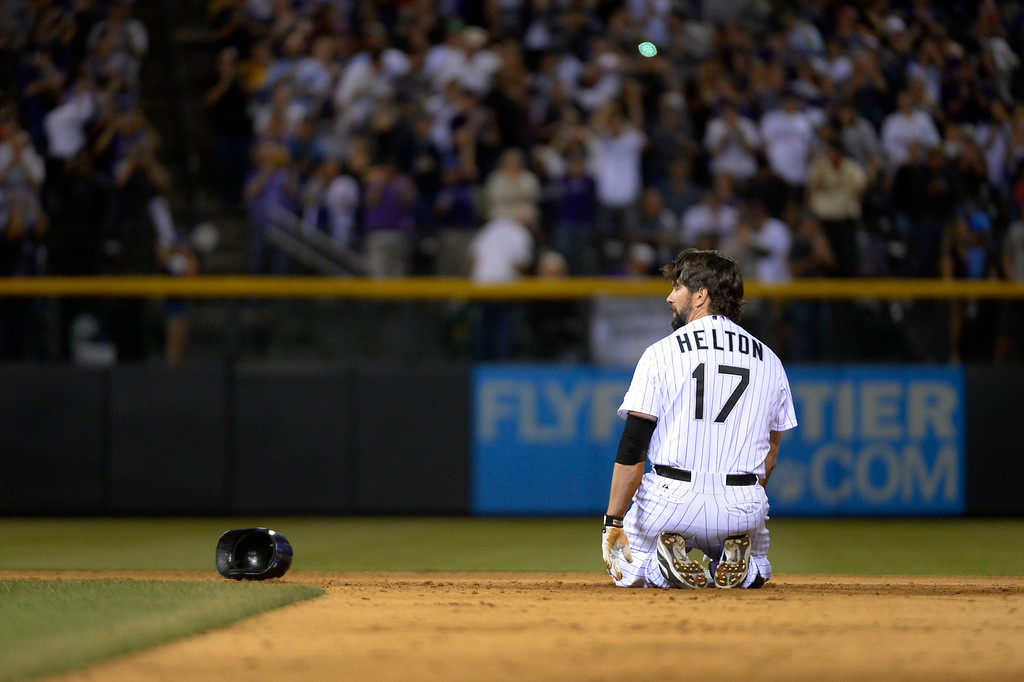 . Todd Helton (17) of the Colorado Rockies sits on second base after sliding in safe on a double in the 5th inning agains the Boston Red Sox September 25, 2013 at Coors Field. (Photo By John Leyba/The Denver Post)