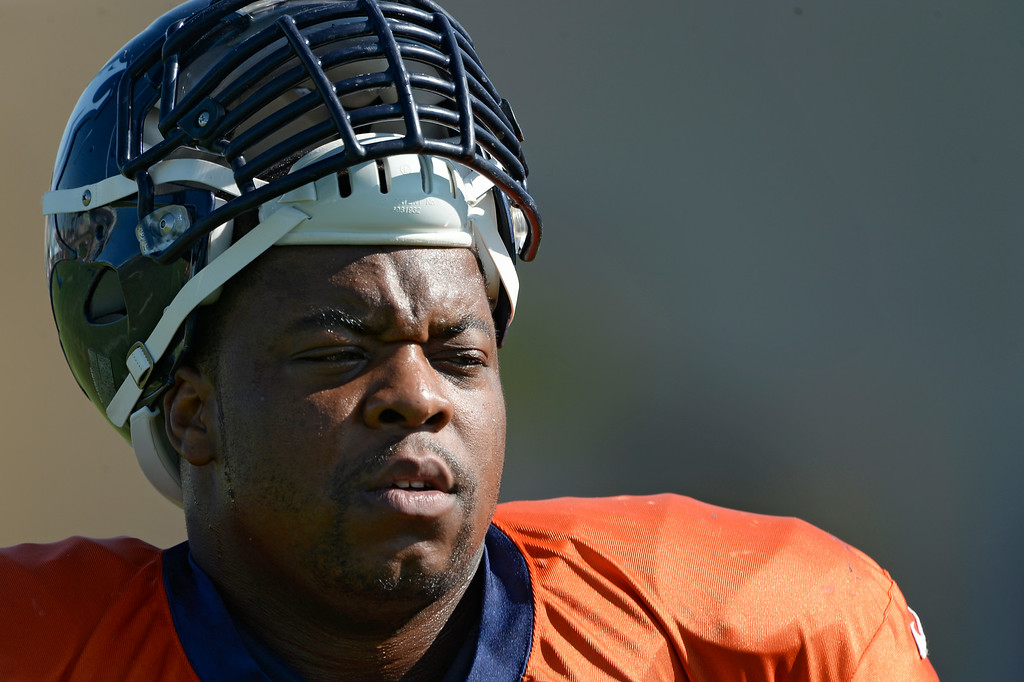 . Denver Broncos defensive tackle Terrance Knighton (98) watches drills during practice at the Denver Broncos 2014 training camp August 12, 2014 at Dove Valley. (Photo by John Leyba/The Denver Post)