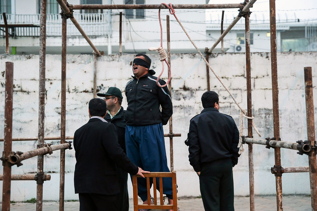 . Balal, who killed Iranian youth Abdolah Hosseinzadeh in a street fight with a knife in 2007, reacts as he stands in the gallows during his execution ceremony in the northern city of Nowshahr on April 15, 2014.  AFP PHOTO/ARASH KHAMOOSHI/AFP/Getty Images