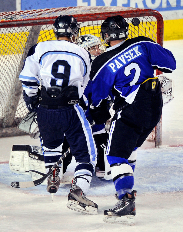 . DENVER, CO. - FEBRUARY 28: Mustangs forward Tim Hunton (9) pressured Cougars goalie Brandan Alcorn (55) in the third period. Ralston Valley High School defeated Resurrection Christian 5-1 Thursday night, February 28, 2013 in a semifinal match in the Colorado State Ice Hockey Championships at Magness Arena in Denver. The Mustangs advanced to play in the title game Friday night. (Photo By Karl Gehring/The Denver Post)