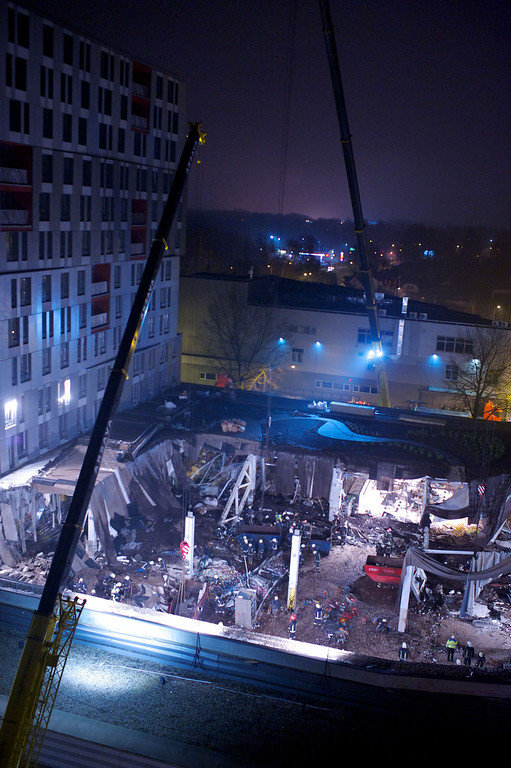 . Rescuers search for survivors on November 23, 2013 at the Maxima supermarket in Riga, after a roof collapsed caving in on shoppers.   AFP PHOTO / ILMARS  ZNOTINS/AFP/Getty Images