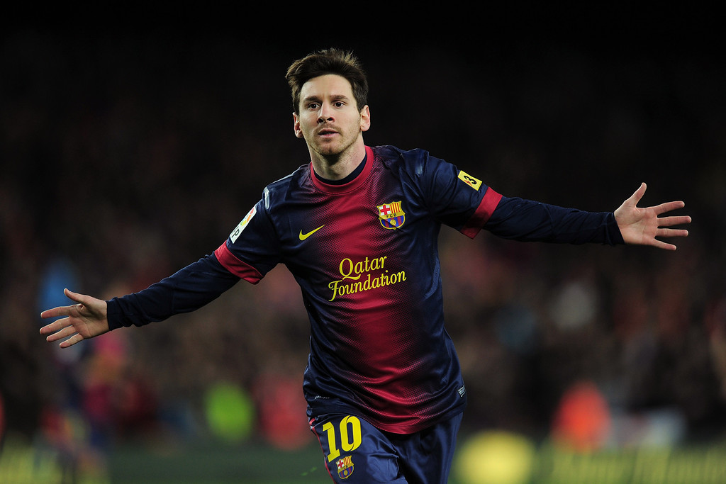 . Barcelona\'s Argentinian forward Lionel Messi celebrates after scoring during the Spanish league football match FC Barcelona vs Atletico de Madrid at the Camp Nou stadium in Barcelona on December 16, 2012.   LLUIS GENE/AFP/Getty Images