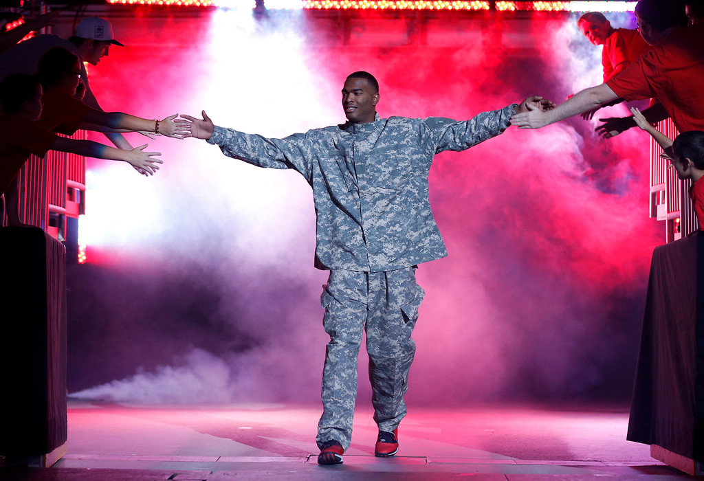 . N.C. State\'s T.J. Warren is introduced to the crowd during the NCAA college basketball team\'s event in Raleigh, N.C., Friday, Oct. 18, 2013. (AP Photo/The News & Observer, Ethan Hyman)