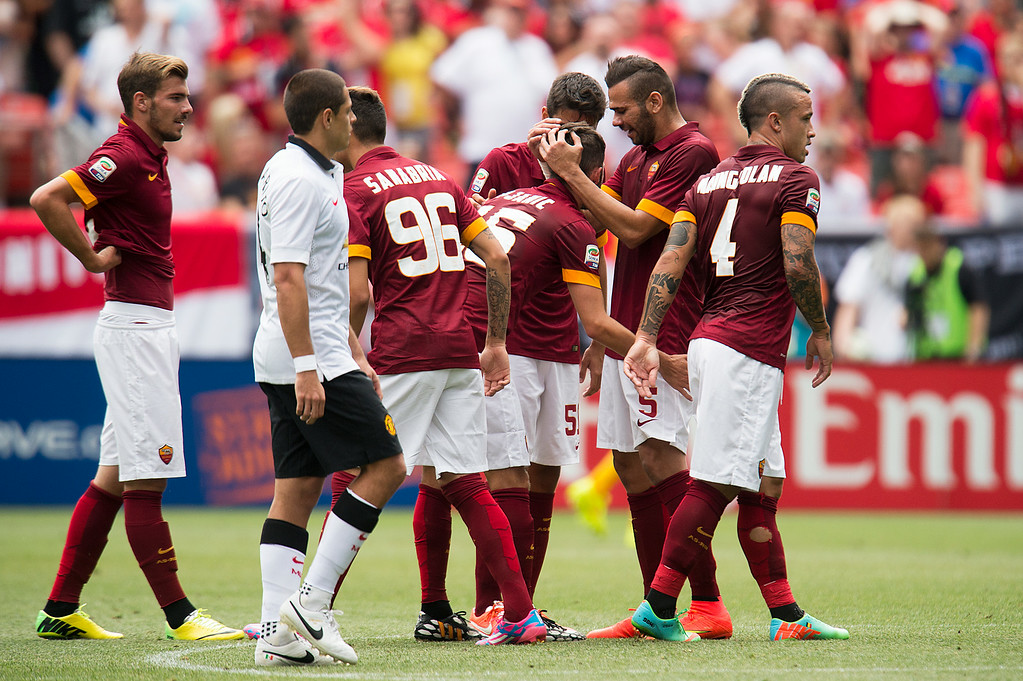 . AS Roma celebrates a goal in the second half against Manchester United during an exhibition match of the Guinness International Champions Cup at Sports Authority Field at Mile High on July 26, 2014, in Denver, Colorado. Manchester United won 3-2. (Photo by Daniel Petty/The Denver Post)